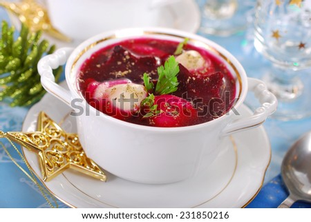 red borscht with mushrooms filled ravioli for christmas eve supper  - stock photo