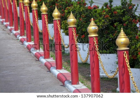 Red boundary fence. - stock photo