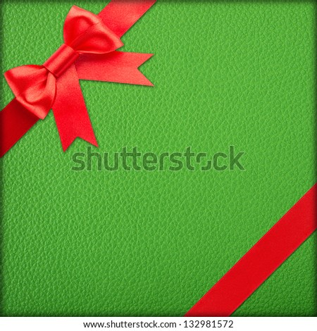 red bow and ribbon over red wrapped gift - stock photo