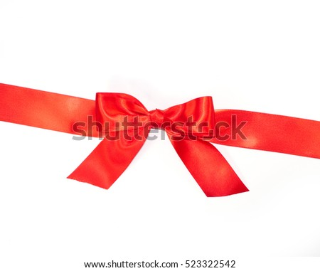 Red bow from ribbon with tails isolated on white background