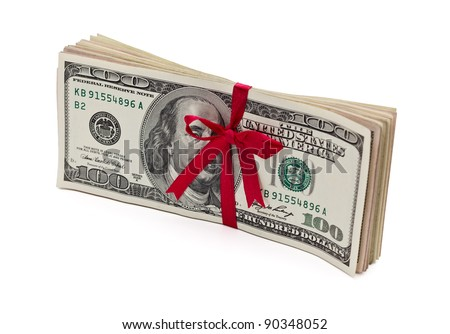 Red bow on a stack of one hundred dollar bills. Isolated white background. - stock photo