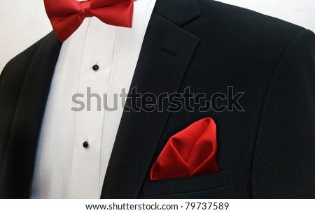 red bow tie with handkerchief accenting a black tuxedo