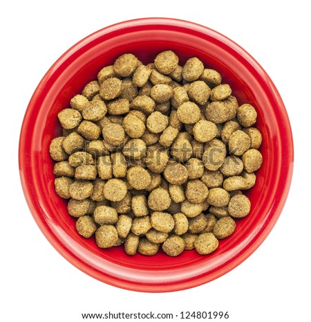 red bowl of dry dog food isolated on white - stock photo