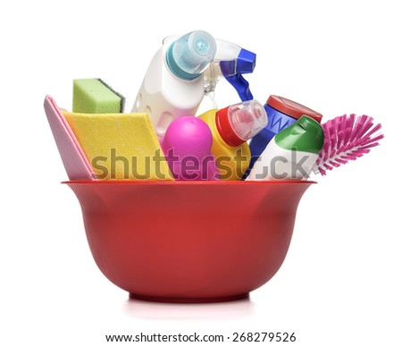 Red bowl with detergent bottles and chemical cleaning supplies on white - stock photo