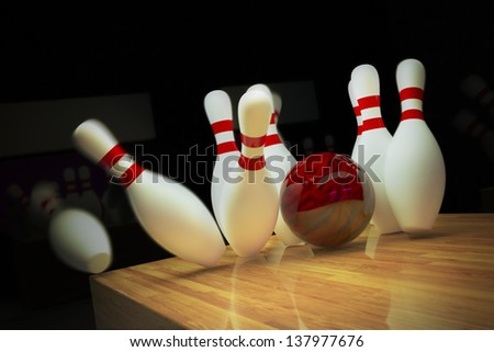 Red bowling ball is making a strike on wooden lane. - stock photo