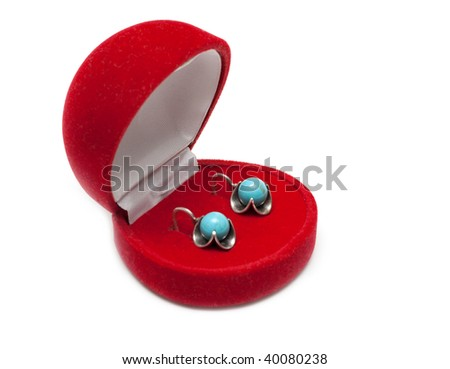 Red box with earring on white background - stock photo