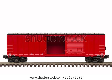 Red Boxcar with open door. - stock photo
