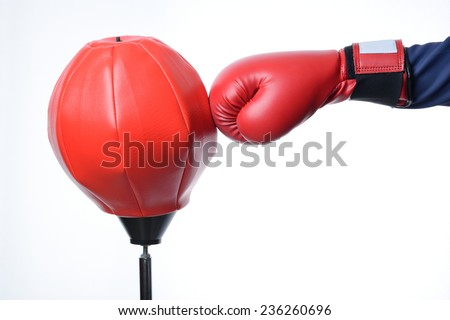 red boxing glove punch a red punching bag exercises isolated in white - stock photo