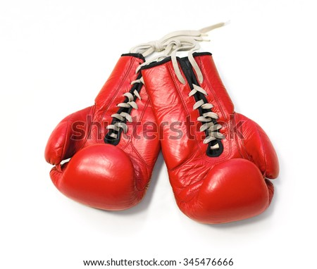 Red boxing gloves on white background - stock photo