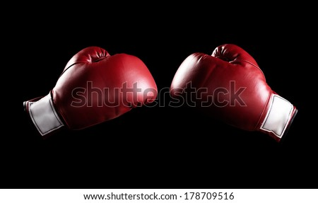 Red boxing gloves with clipping path. - stock photo