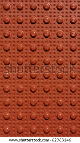 red braille background texture with dots - stock photo