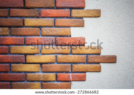 Red brick and concrete wall - stock photo