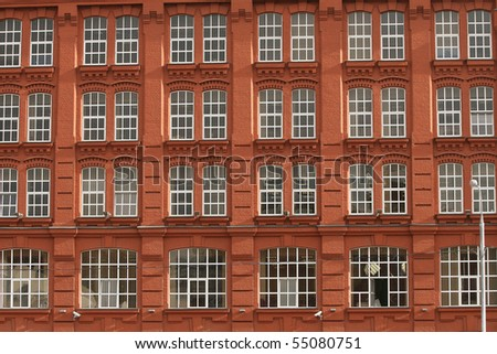 Red brick building with white windows