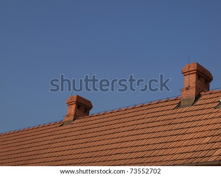 red-brick chimneys on the roof of red tiles