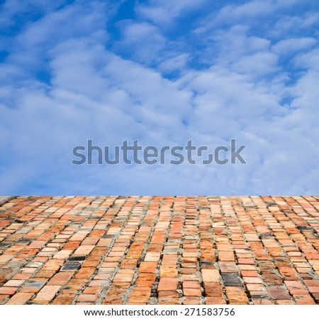 red brick floor against the sky