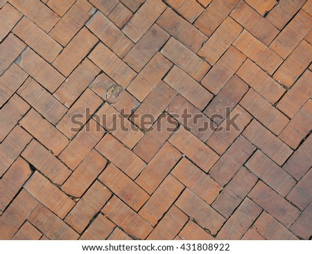 Red brick paving stones flooring texture for background and design.