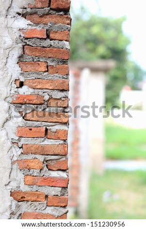 Red brick pillars are not plastered - stock photo