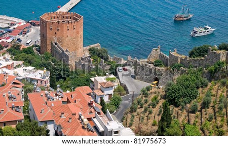 Red brick tower in port of Alanya, Turkey - stock photo