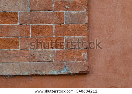 red brick wall and painted red wall background