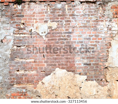 red brick wall background texture, damaged plastered wall as grunge background - stock photo