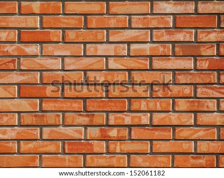 Red brick wall on a sunny day - stock photo