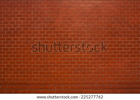 Red brick wall suitable for a background. - stock photo