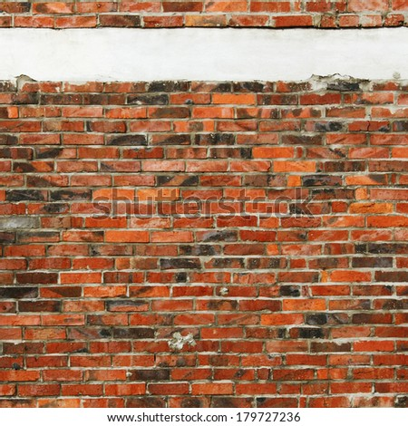 red brick wall texture background and horizontal strip of plaster - stock photo