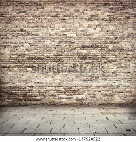 red brick wall texture grunge background, loft or basement with tile floor - stock photo
