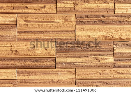 Red brick with patterns and color combinations of brown color as a wall - stock photo