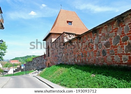 Red bricks and stones fortification in old Vilnius city. Lithuania. - stock photo