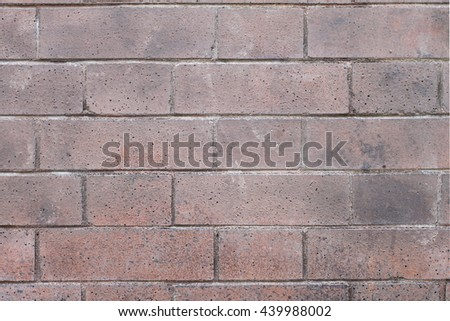 Red bricks wall with an regular pattern as a background - stock photo