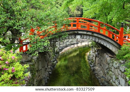 red bridge in a japanese garden in summer kyoto