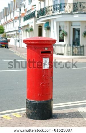 red British mail box on a city street - stock photo