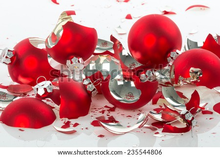 Red broken Christmas balls over a white background - stock photo
