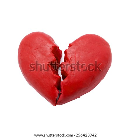 Red broken heart shape play dough isolate on white background.  - stock photo