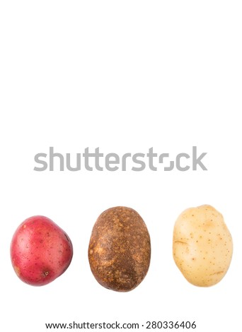 Red, brown, yellow potatoes on white background - stock photo