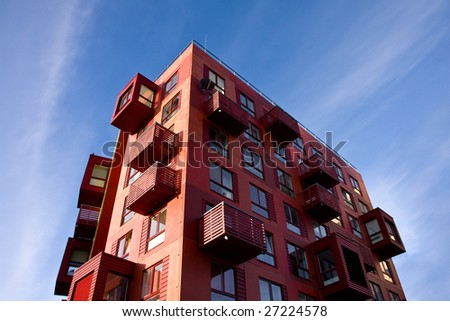 Red building and blue sky. Vertical. More buildings in my portfolio. - stock photo