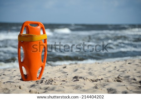 Red buoy for a lifeguard to save people from drowning - stock photo