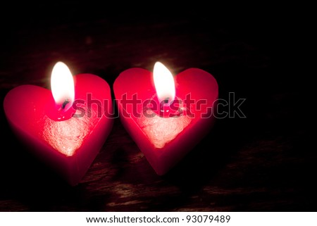 Red burning heart shaped candles - stock photo