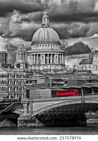 Red bus crossing a London bridge - stock photo