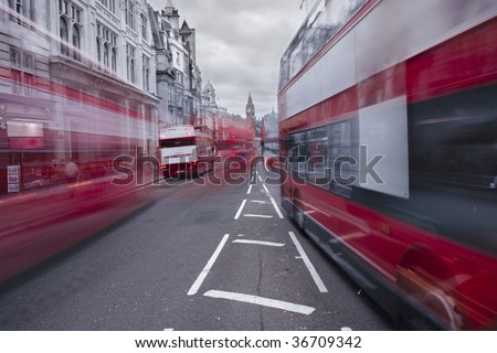 Red buses in London with Big Ben in the background - stock photo
