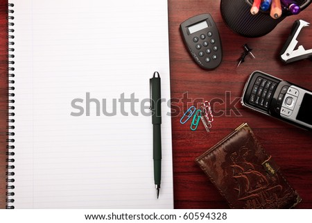 red business desk with office stationery - stock photo