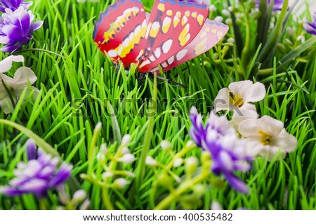 Red butterfly on the grass. Beautiful scenery - stock photo
