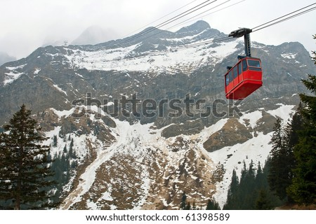 Red cable car railway and landscape of Pilatus Mountain at Lucern Switzerland - stock photo