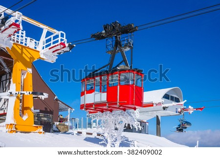 Red cable car railway, cable way, in ski resort Oberwiesenthal, Saxony, Germany - stock photo