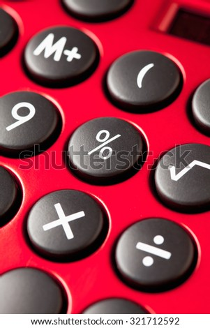 Red calculator, close up - stock photo