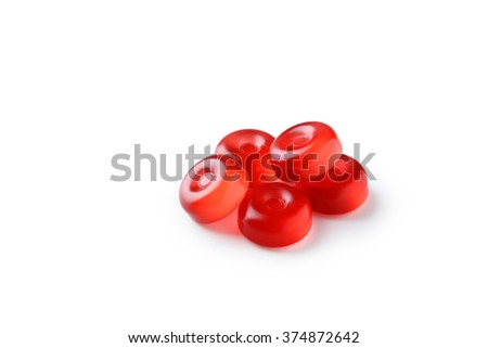 Red candies isolated on white - stock photo
