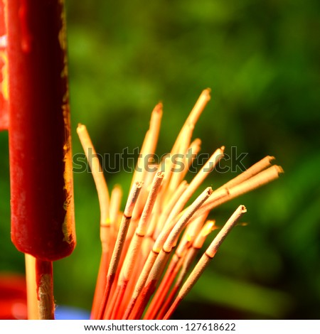 Red candle and incense for Chinese worship ceremony. - stock photo