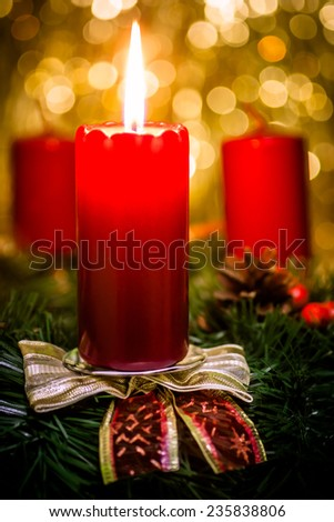 red candle on a gold background - stock photo