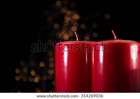 Red candle with fire against defocused lights - stock photo